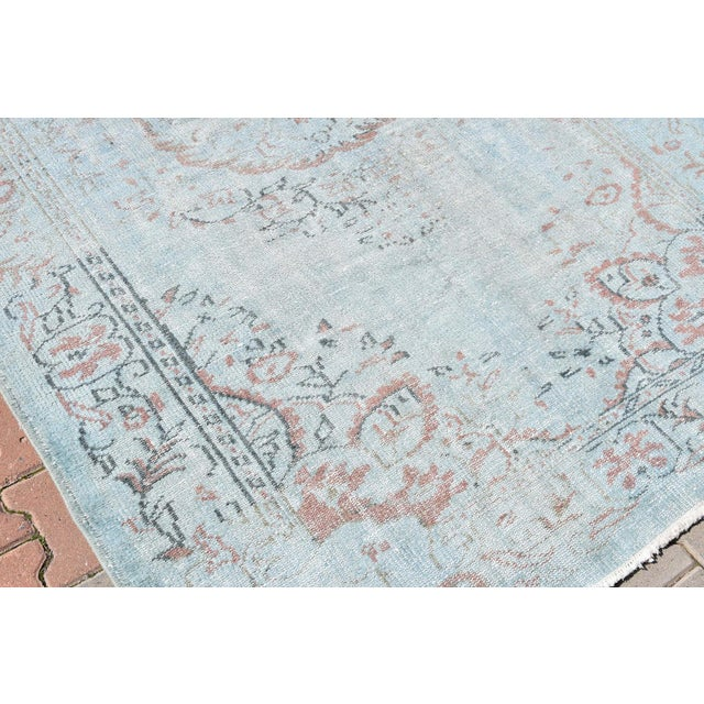 Image of Vintage Oushak Sky Blue Distressed Handwoven Area Carpet -5′5″ × 8′2″