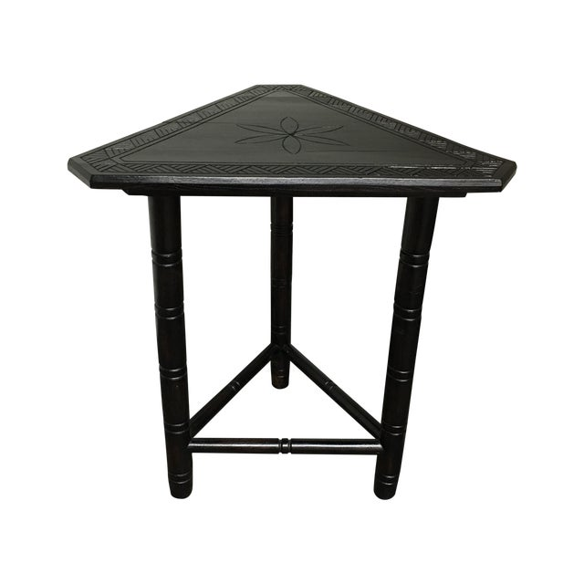 Black triangular carved side table chairish