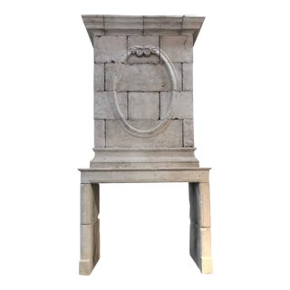 18th Century Limestone Mantel with Hand Carved Trumeau