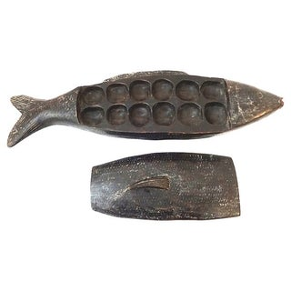 African Mancala Game in Wooden Fish