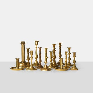 A Collection of sixteen brass candle sticks, various sizes and shapes.