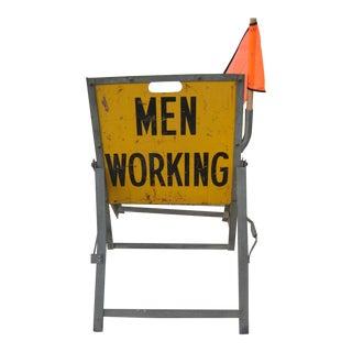 Men Working Roadside Sign