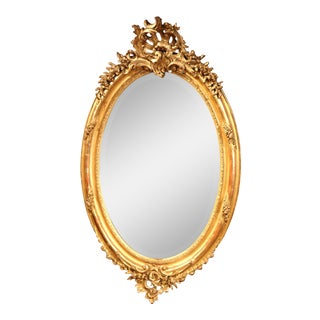 19th Century French Louis XV Carved Gold Leaf Oval Mirror with Bevelled Glass