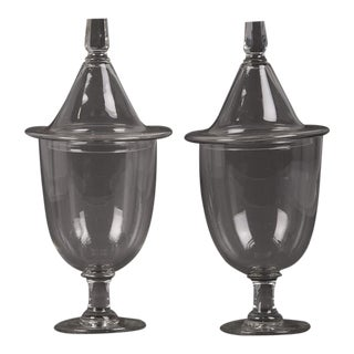 A pair of Regency style glass urns each with a lid, England c. 1880