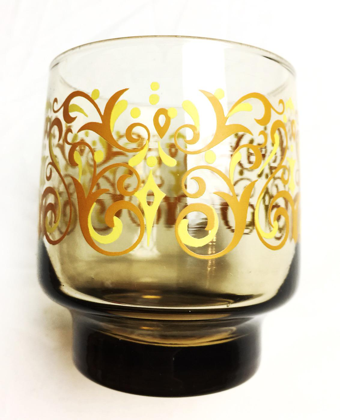 image of vintage 1960s amber colored libbey glassware with yellow and orange retro designs set - Libbey Glassware