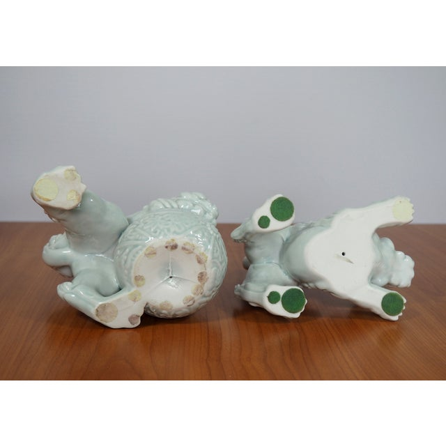 Image of Porcelain Celadon Foo Dog Statues - A Pair
