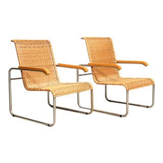 Vintage Chrome and Rattan Lounge Chairs – pair