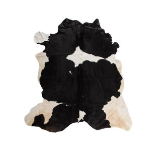 Black & White Cowhide Area Rug - 5′7″ × 6′7″