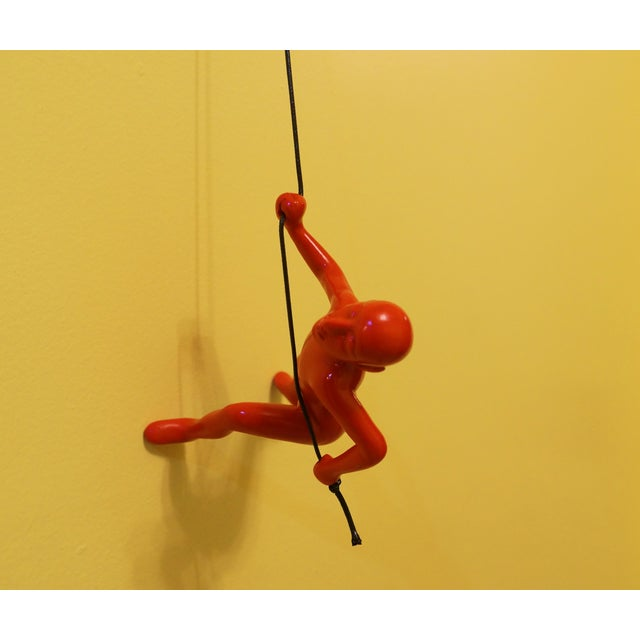 Image of Red Climbing Man Wall Art
