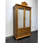 Image of Baker Cane-Cut Armoire With Wire Mesh Doors