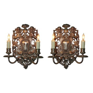 Pair of Bronze Cherub Form Sconce by Caldwell