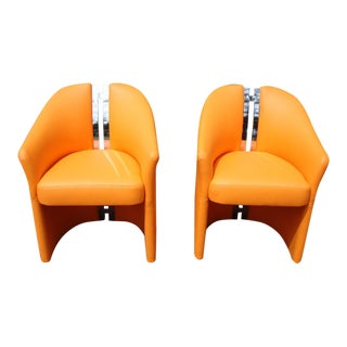 "Pair of Chairs in Orange Leather and Chrome ""H"" Spine"