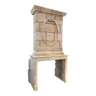 18th Century Limestone Mantel with Hand-Carved Trumeau