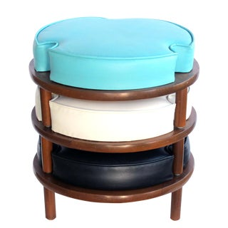 A mod and fun American mid-century set of three round stackable stools