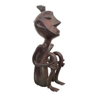 Iron Sitting Man Sculpture