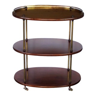 A handsome English 3-tier solid mahogany oval etager with brass mounts
