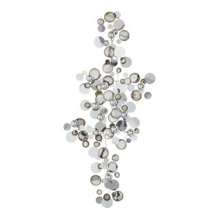 A Large Chrome Raindrops Wall Sculpture