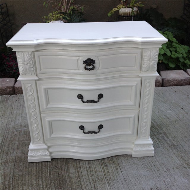 Image of Ornate White Three-Drawer Nightstand