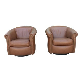 Leather pair of swivel chairs