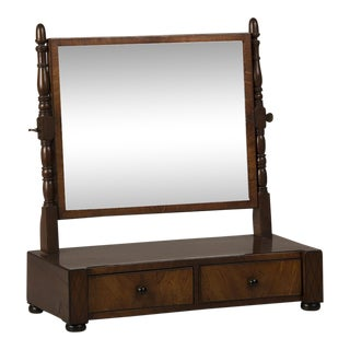 A William IV period mahogany dressing mirror with turned columns, having two drawers and standing on bun feet from England c. 1830