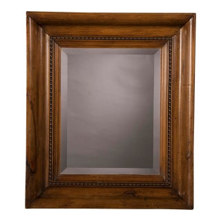 A classic pine frame constructed of salvaged moulding from a building near Wales c. 1880 now enclosing a beveled mirror glass (24 1/2″w x 28 3/4″h)
