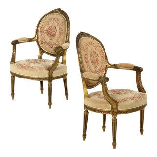 French Louis XVI Carved Giltwood Arm Chairs - A Pair