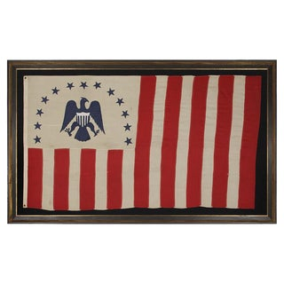 RARE REVENUE CUTTER SERVICE FLAG WITH A BLUE EAGLE AMID AN ARCH OF 13 BLUE STARS
