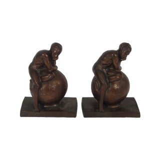 Boy Sitting on Top of the World Bookends