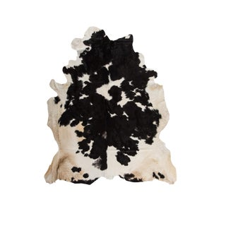Handmade Black & White Cowhide Area Rug - 6′ × 7′