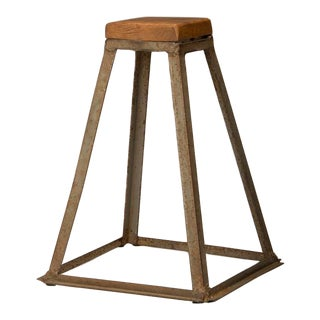 An iron and wood stand originally used as a stand for a dog act in a regional traveling circus found in France