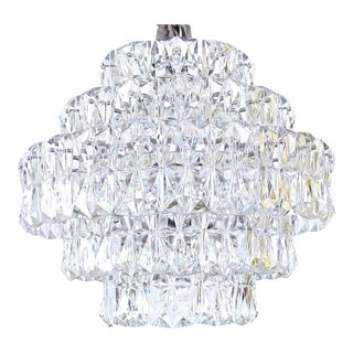 A stiking German 1960's Kindeldey Lighting 5 tier chandelier with polished chrome frame and molded crystals