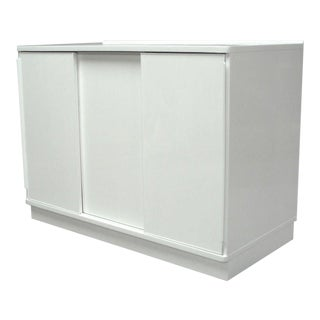 A White Lacquered Sliding Door Cabinet by Edward Wormley