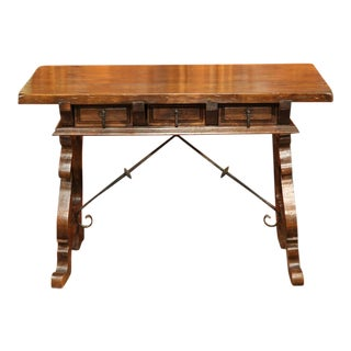 Early 20th Century Spanish Walnut Desk With Drawers and Iron Stretcher
