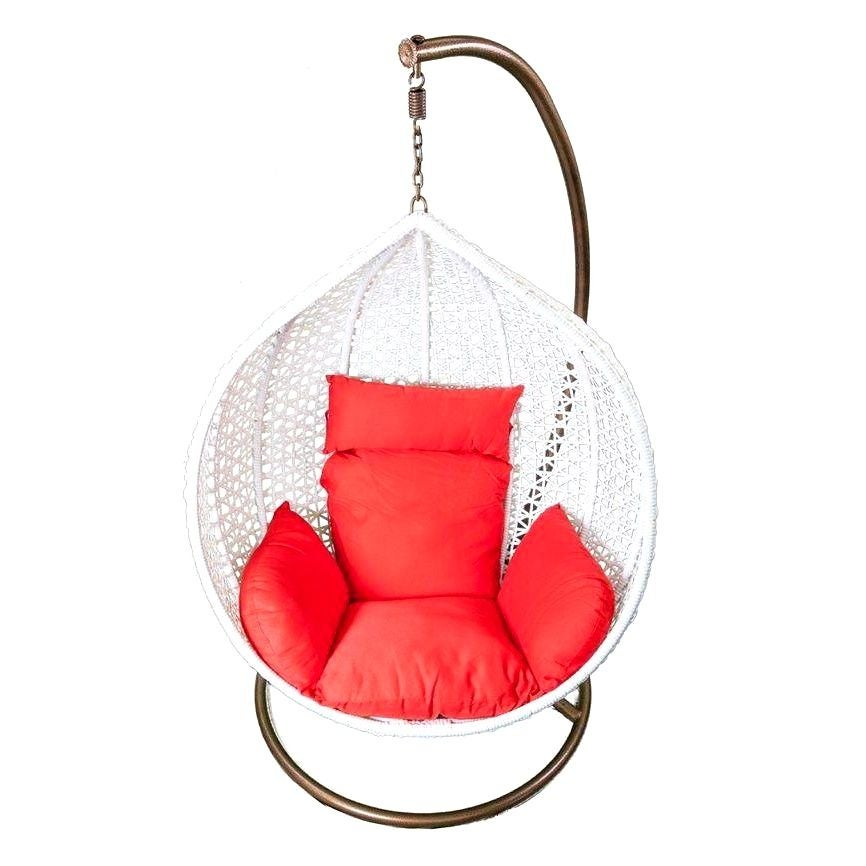 Hanging white rattan chair with red cushions chairish