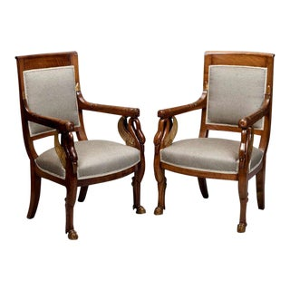 Pair Early 19th Century French Empire Mahogany and Parcel Gilt Arm Chairs