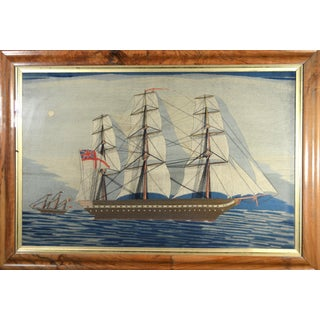 Sailor's Woolwork of the Royal Navy Frigate H.M.S. Warrior with White Ensign, Old label with the Makers Name. Circa 1881.