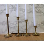 Image of Vintage Graduated Brass Candlesticks - Set of 4