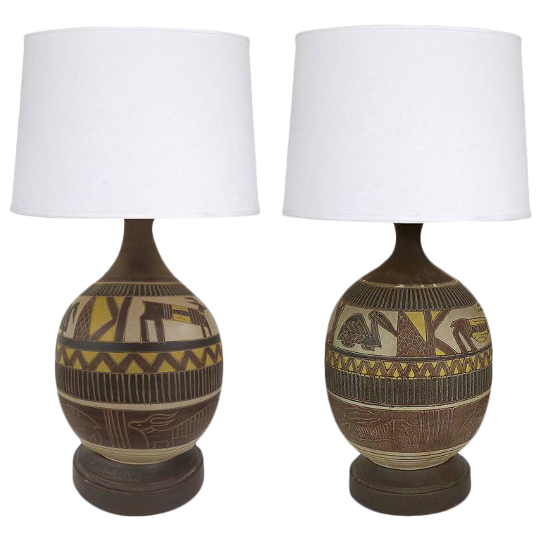 midcentury incised animal earthenware lamps a pair