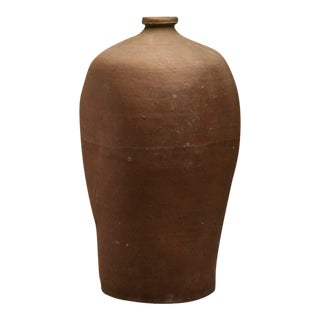 A large earthenware bottle from France