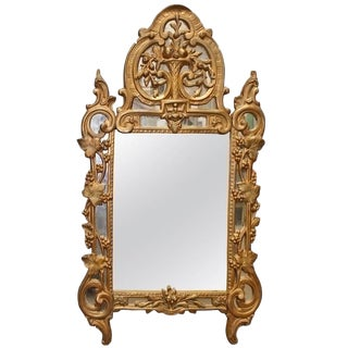 A French Regence Style Small Scaled Gilt Wood Mirror