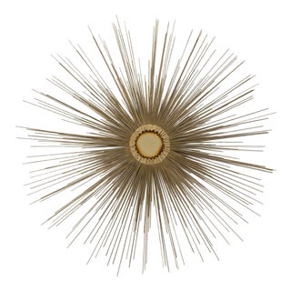A Sunburst Wall Sculpture Polished Brass Centre 1970s