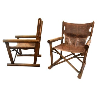A pair of folding directors chairs by Sergio Rodrigues