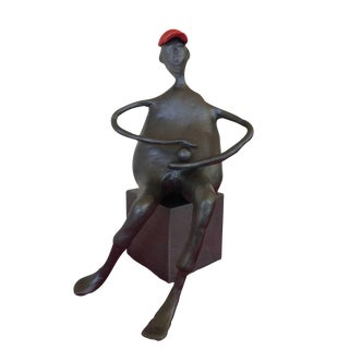 Man With Hat & Ball Sculpture