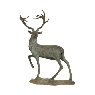 An extraordinary near life size bronzed metal sculpture of a stag in mid turn found in France