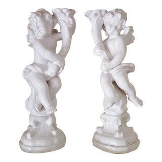 Pair of European Porcelain Cherub Candlesticks