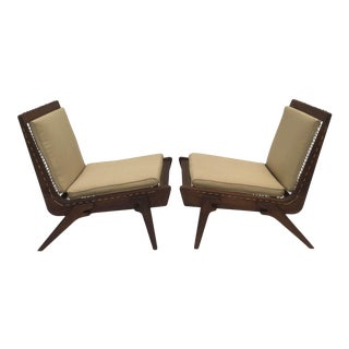 Pair of limited edition George Allen lounge chairs