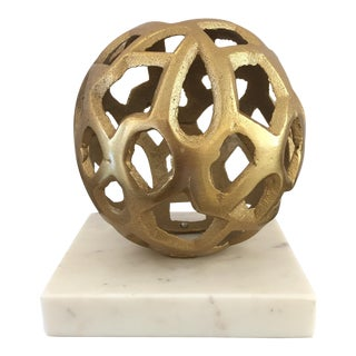 Geometric Golden Sphere on Marble