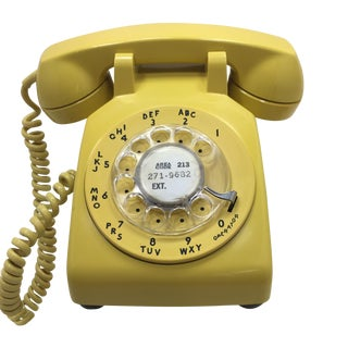 Bright Yellow Rotary Dial Telephone