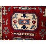 Image of 1970s Vintage Caucasian Kazak Rug - 4′ × 6′