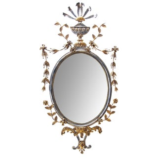 Chic & good quality Italian 1960's silver and gold gilt metal oval mirror w trophy crest and floral and foliate swags; attributed to Palladio, Italy